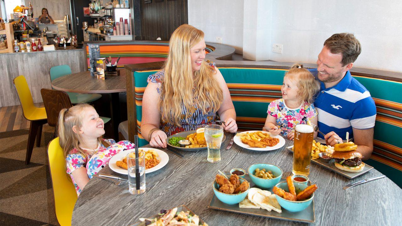 family eating jetty restaurant Devon